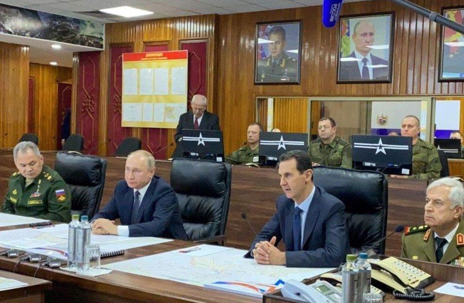 على-كرسي-صغير-وخلفهما-صور-بوتين--هكذا-تم-إذلال-الأسد--ووزير-دفاعه-بدمشق